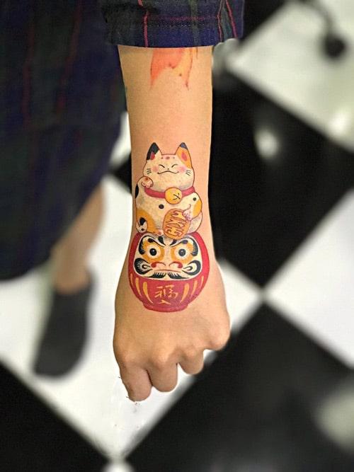 Mau Tattoo Meo Than Tai Va Daruma O Tay Dieu Da